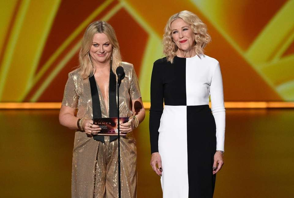 Amy Poehler, left, and Catherine O'Hara present the