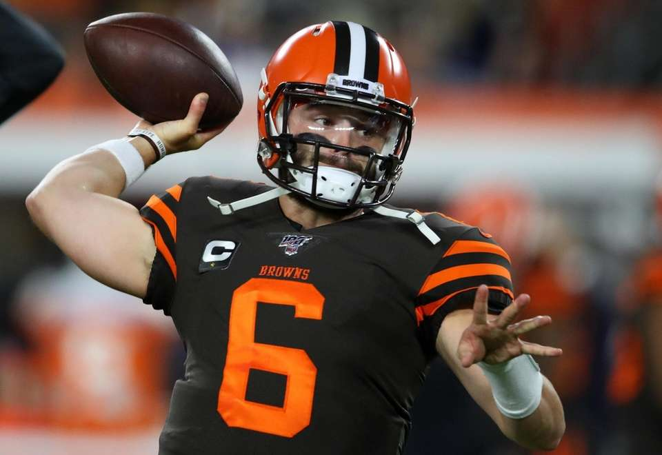 Quarterback Baker Mayfield of the Cleveland Browns warms