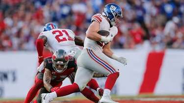 Giants rookie linebacker Ryan Connelly looks for running
