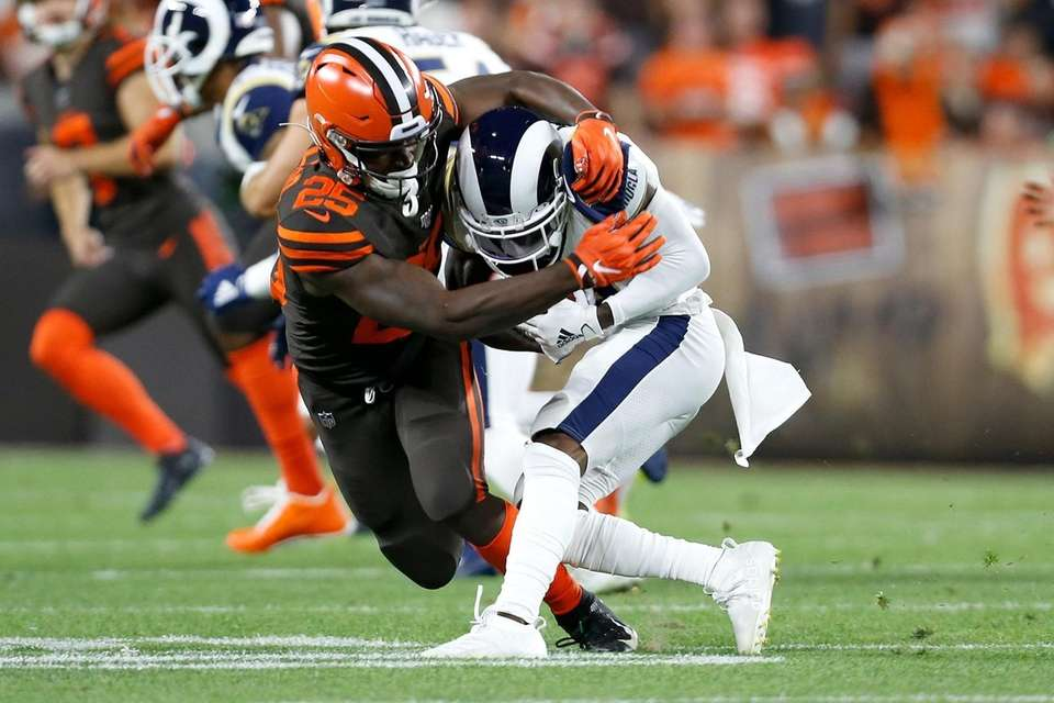 Dontrell Hilliard of the Cleveland Browns tackles JoJo