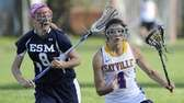 Sayville's Madison Hoon is defended by Eastport-South Manor's