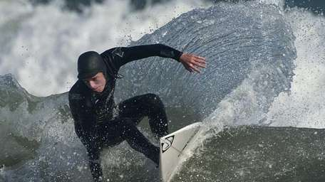 Surfers taking advantage of this summer like weather
