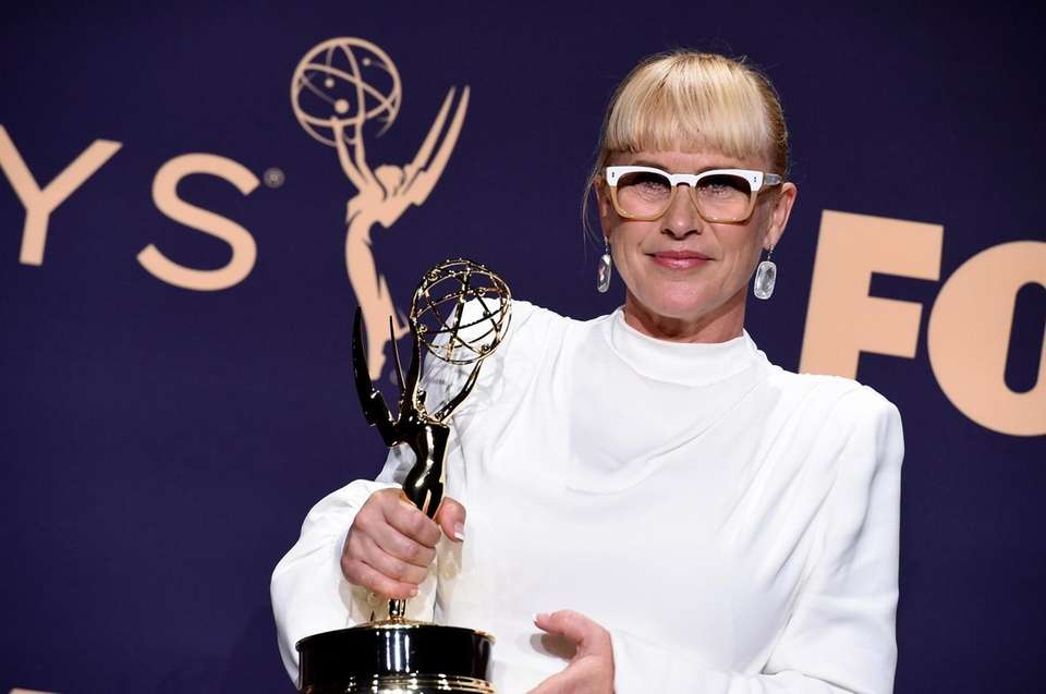 Patricia Arquette poses in the press room with