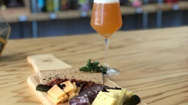 A charcuterie board and double IPA at Hops