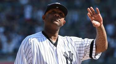 Yankees pitcher CC Sabathia waves to fans during