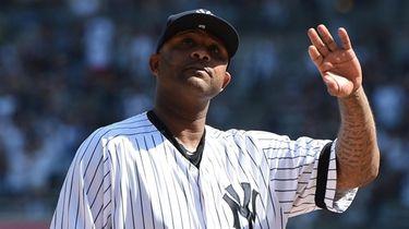Yankees pitcher CC Sabathia waves to fans during