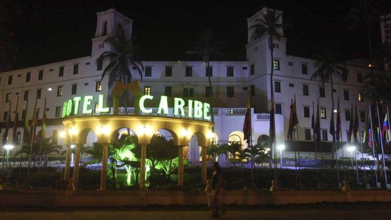 People walk past Hotel El Caribe in Cartagena,