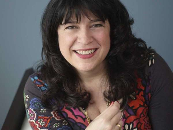 Author E.L. James signs copies of her novels,