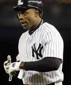 Curtis Granderson reacts after beating a throw to