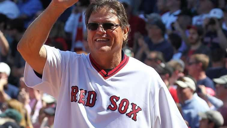 Ex-Red Sox player Carlton Fisk enters the field