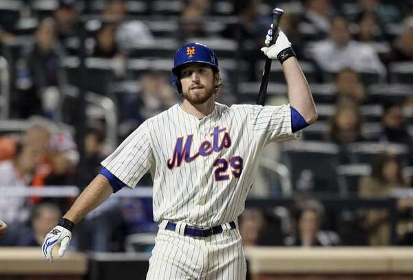 Ike Davis of the Mets reacts after striking