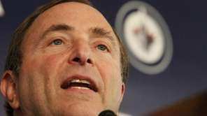 NHL commissioner Gary Bettman talks to the media