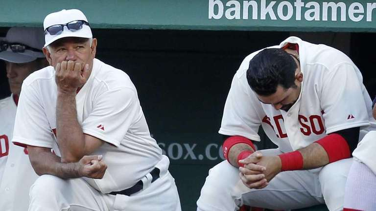 Boston Red Sox manager Bobby Valentine watches from