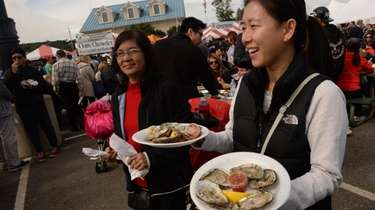 Elizabeth Yoon, right, from Great Neck, with plates