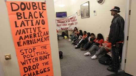 Protesters and students stage a sit-in protest at