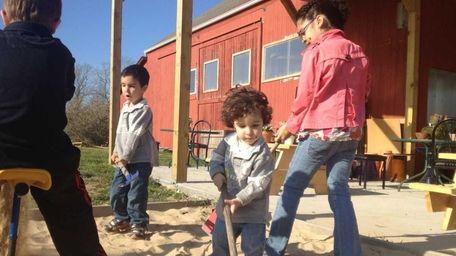 Jemir Aidyn, 1, played with his siblings in