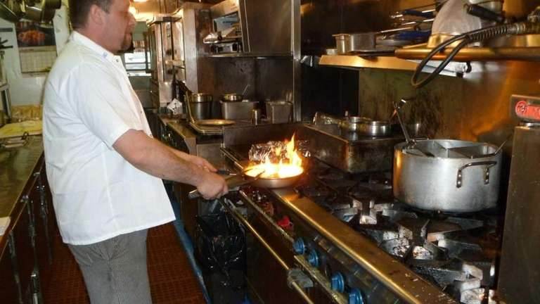 Chef Andy Kuna prepares food for hungry customers
