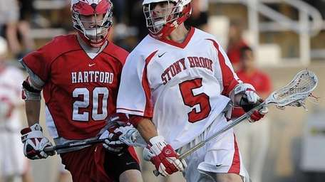 Stony Brook midfielder Russ Bonanno drives to the