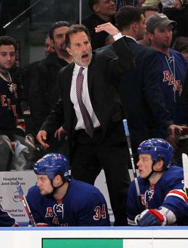 John Tortorella of the New York Rangers motions