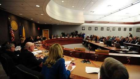 The Suffolk County Legislature hears a report on