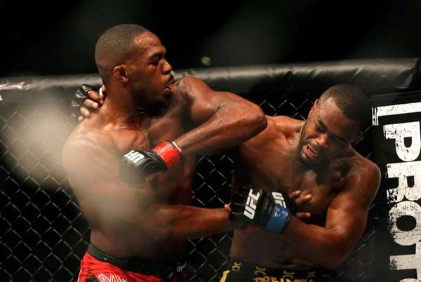 Jon Jones elbows Rashad Evans during a light