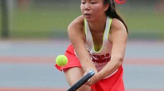 Cold Spring Harbors Serena Li returns a serve