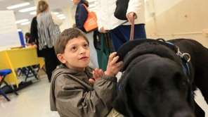 Adrian Ponce, 7, of Yorktown, visits the sixth