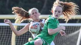 FarmingdaleÕs Emma Best (green) goes up for the