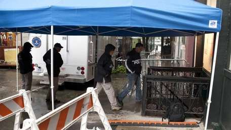 FBI and NYPD forensic teams continue to search