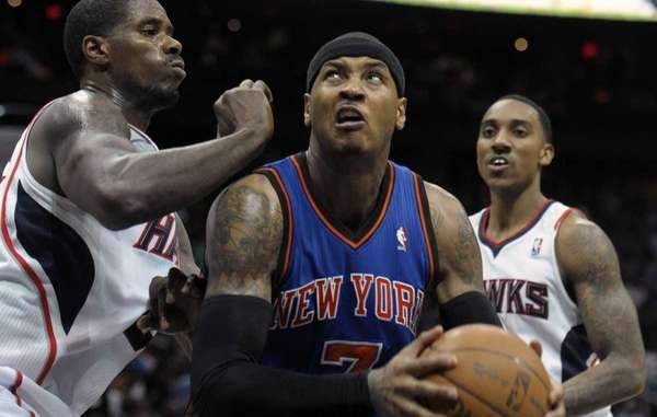 New York Knicks forward Carmelo Anthony, center, looks