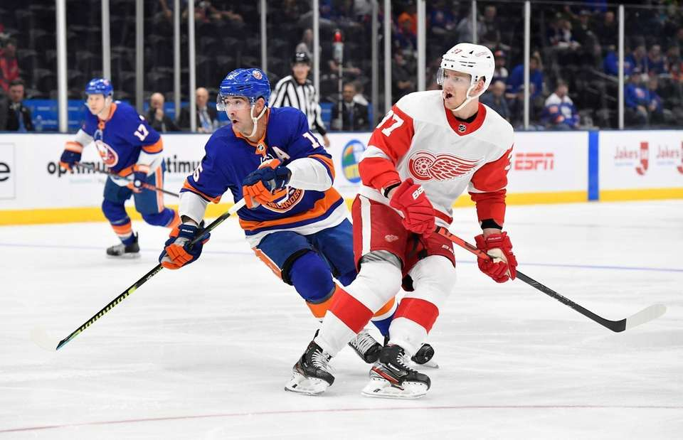 Cal Clutterbuck of the Islanders and Evgeny Svechnikov