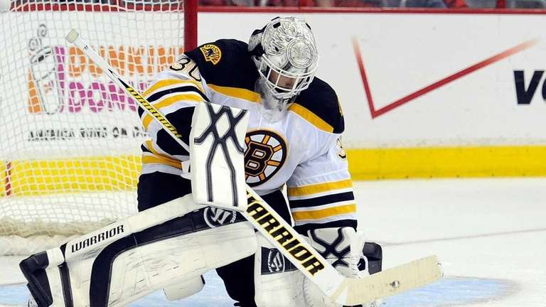 Tim Thomas of the Boston Bruins makes a