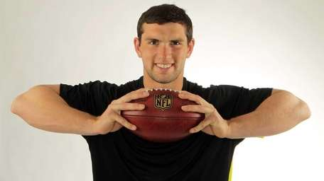 Andrew Luck posing during the NFL combine, in