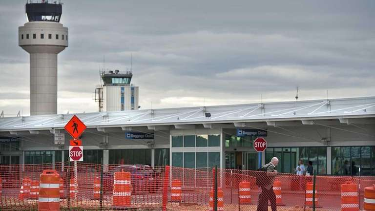 MacArthur Airport at a crossroad with lot of