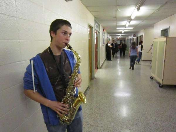 Junior David Barton, 17, practices on his saxophone