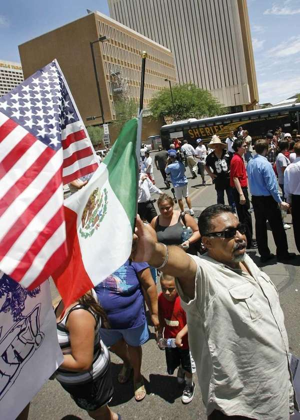 Demonstrators protest Arizona's SB1070 immigration-enforcement law in front