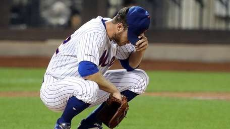 Mets starting pitcher Steven Matz reacts on the
