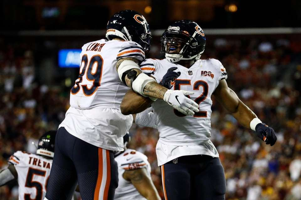 Chicago Bears linebackers Aaron Lynch (99) and Khalil