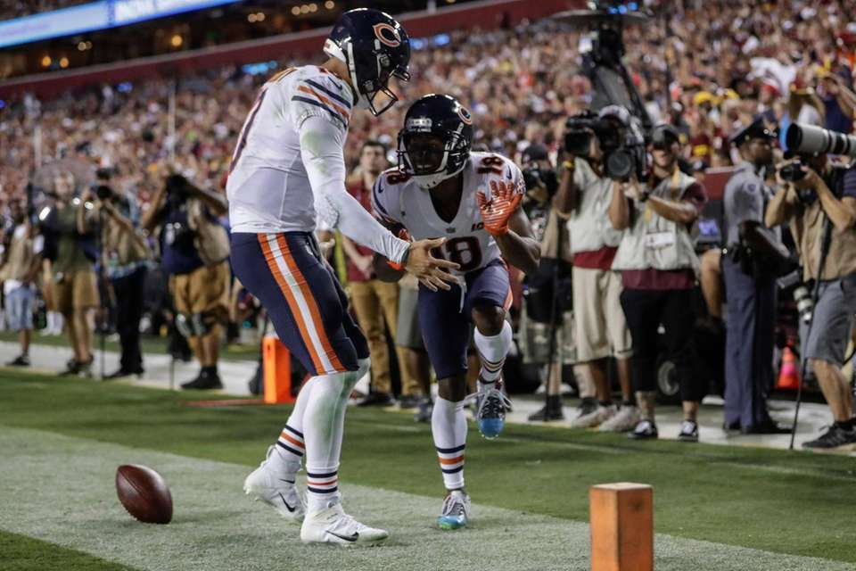 Bears quarterback Mitchell Trubisky, left, celebrates after connecting