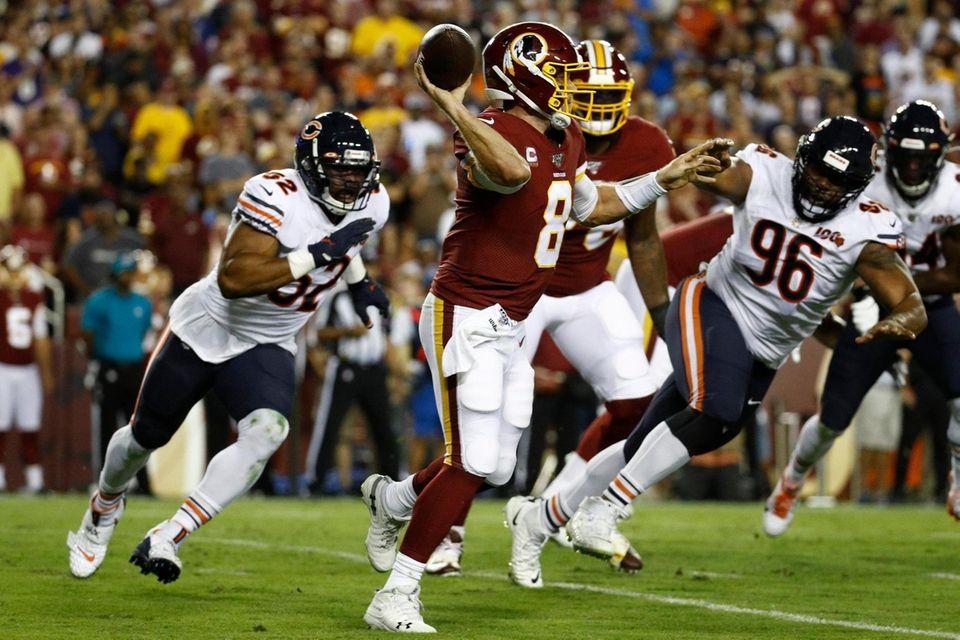 Washington Redskins quarterback Case Keenum throws under pressure