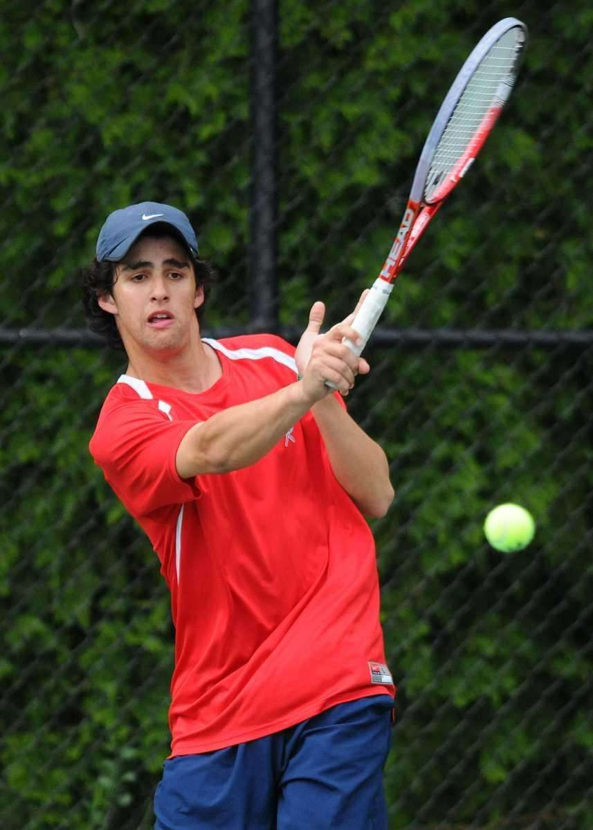 Conor Dauer of Cold Spring Harbor returns a