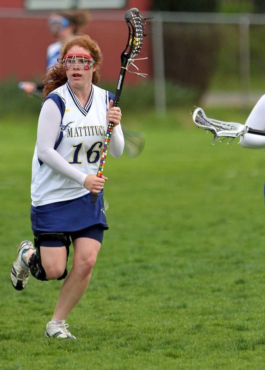 Mattituck M Meg Glenn #16 looks to pass