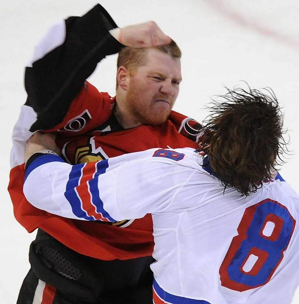 Ottawa Senators' Chris Neil fights New York Rangers'