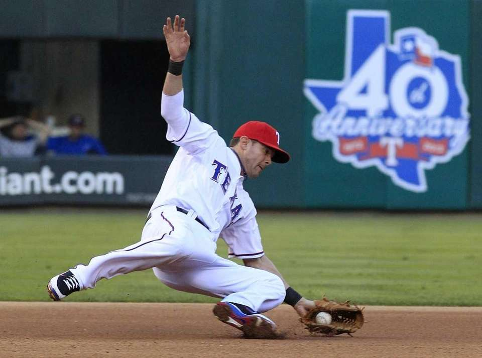 Texas Rangers third baseman Michael Young catches a