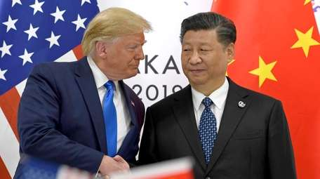 U.S. President Donald Trump shakes hands with Chinese