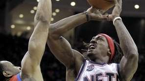 New Jersey Nets' Gerald Wallace (45) goes up