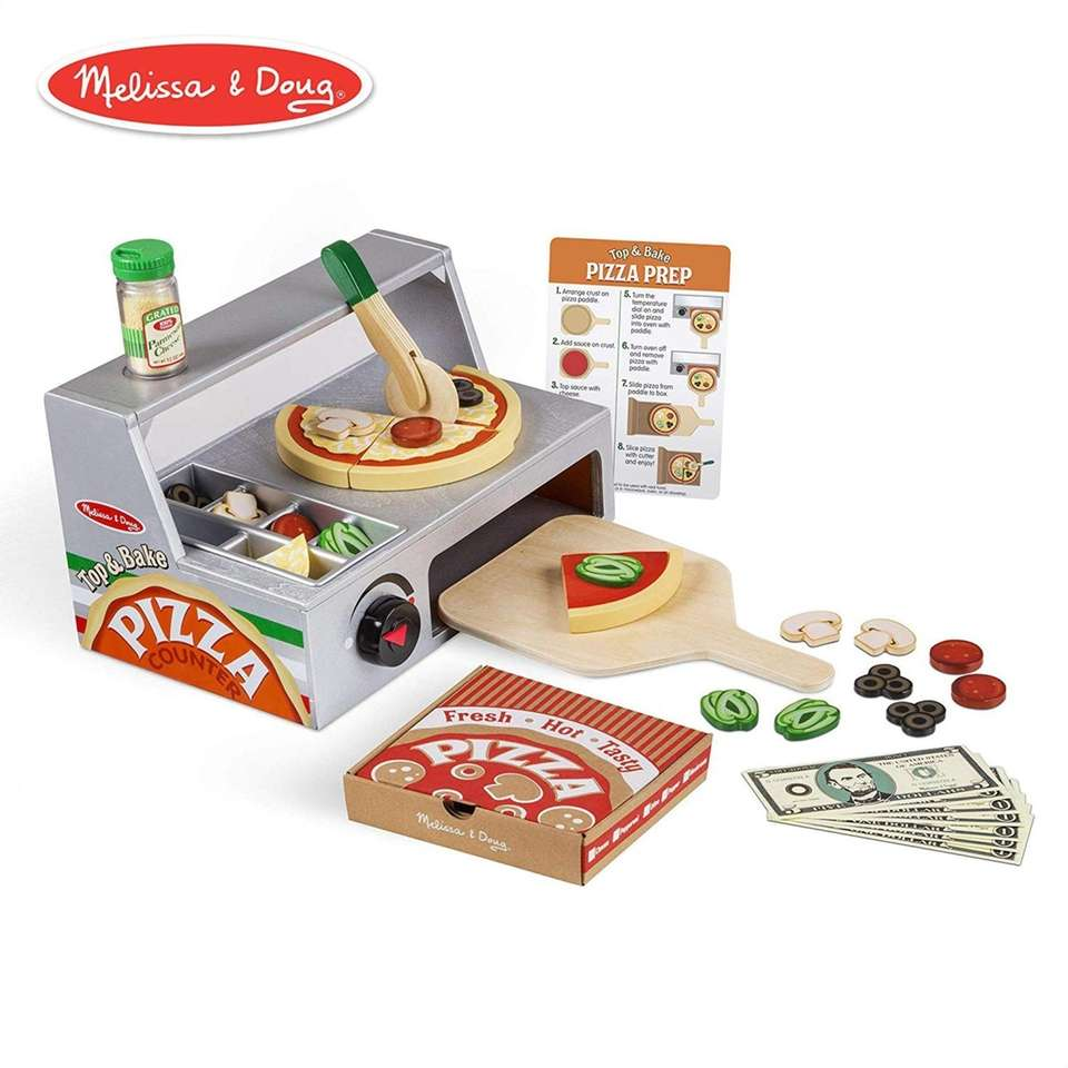 This wooden pizza-making set comes with 34 pieces