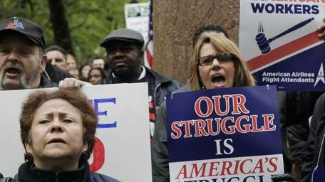 Members of American Airlines' unions rally in Manhattan