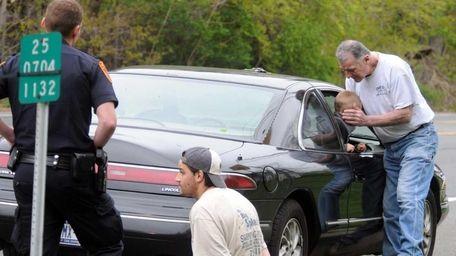 Orlando Catapano comforts his grandson as the driver