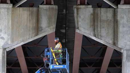 A worker uses a lift to perform work